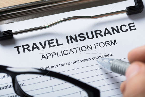 Person Filling Travel Insurance Form Stock photo © AndreyPopov