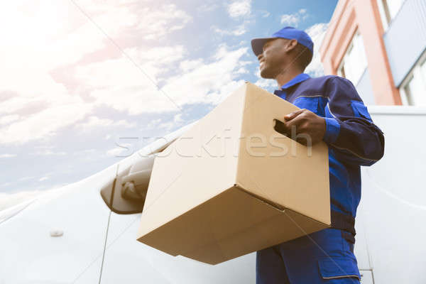 Loader Man With Cardboard Box Stock photo © AndreyPopov