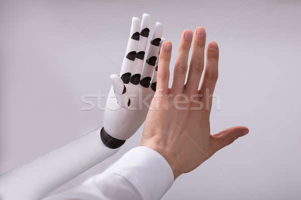 Robot And Man Giving High Five Stock photo © AndreyPopov