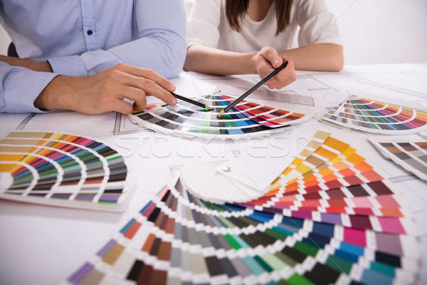 Two Architect Choosing Color From Various Colorful Swatches Stock photo © AndreyPopov