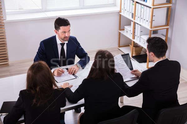 Conversa escritório ver jovem Foto stock © AndreyPopov