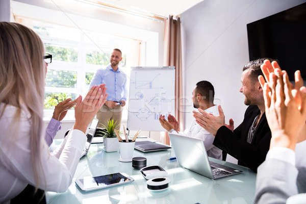 Stock photo: Businesspeople Applauding Their Colleague After Presentation