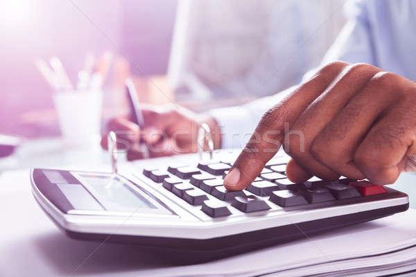 ビジネスマン クローズアップ 電卓 職場 ビジネス ストックフォト © AndreyPopov