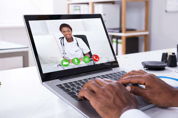 Person Video Conferencing With Female Doctor Through Laptop Stock photo © AndreyPopov