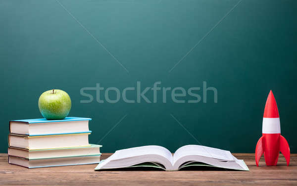 Fresh Apple, Books And Rocket On Desk Stock photo © AndreyPopov