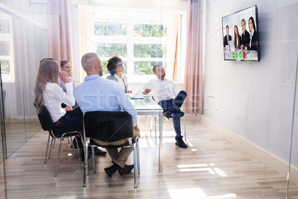 Group Of Diverse Businesspeople Video Conferencing In Boardroom Stock photo © AndreyPopov
