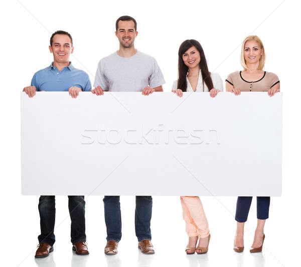 Csoport barátok tart plakát fehér buli Stock fotó © AndreyPopov