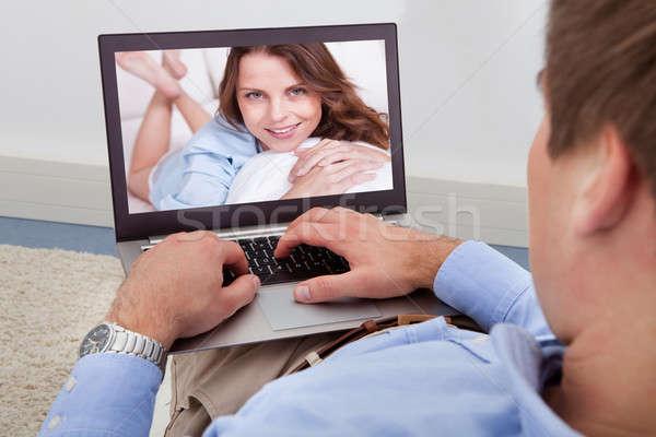 Man Video Chatting On Laptop Stock photo © AndreyPopov
