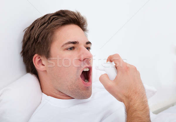 Man Using Asthma Inhaler Stock photo © AndreyPopov