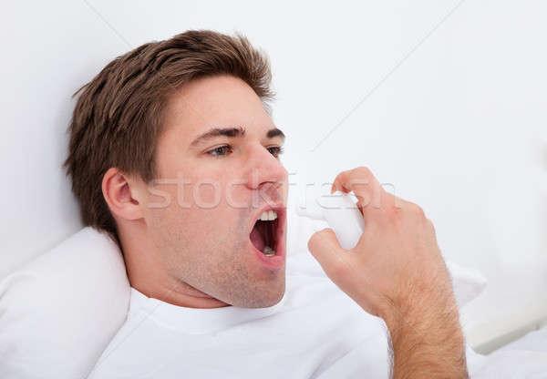 Stock photo: Man Using Asthma Inhaler