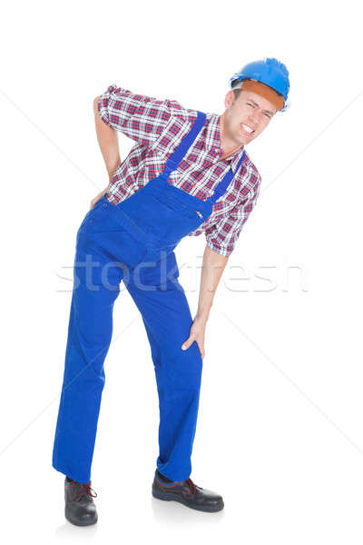 Portrait Of A Worker With Back Pain Stock photo © AndreyPopov