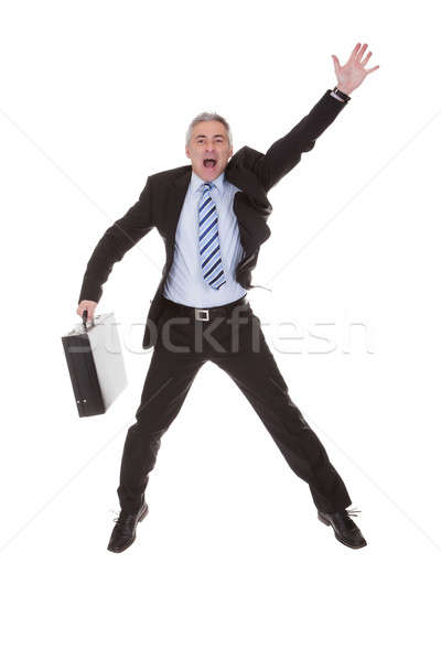 Worried Businessman Hailing A Cab Stock photo © AndreyPopov