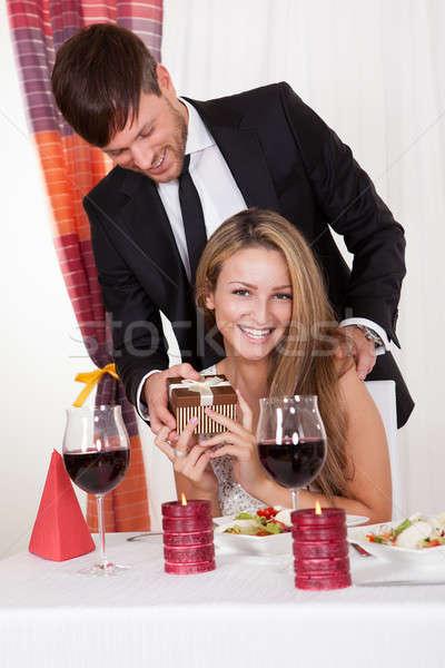 Férfi meglepő feleség ajándék jóképű fiatalember Stock fotó © AndreyPopov