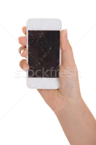 Hand smartphone gebarsten scherm witte Stockfoto © AndreyPopov