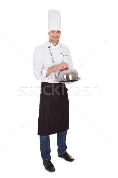 Portrait of happy chef holding tray Stock photo © AndreyPopov