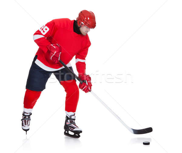 Professional hockey player skating on ice Stock photo © AndreyPopov