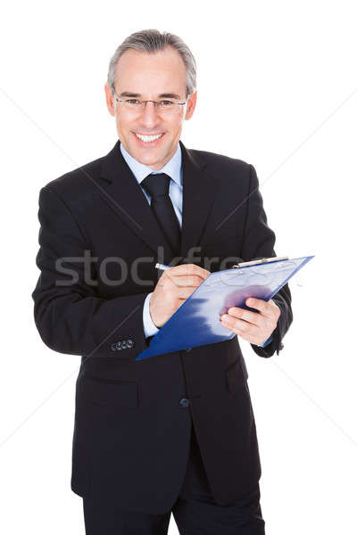 Mature Businessman With Clipboard Stock photo © AndreyPopov