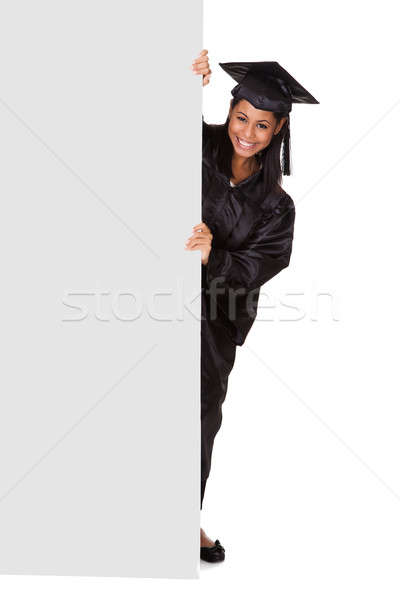 Graduate Woman Holding Placard Stock photo © AndreyPopov