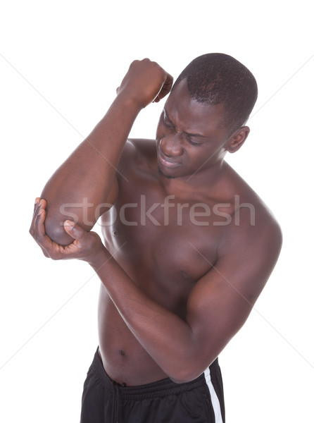 Young Man Suffering From Elbow Pain Stock photo © AndreyPopov
