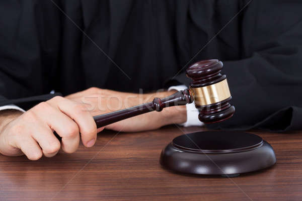 Judge Striking Gavel On Block At Desk Stock photo © AndreyPopov