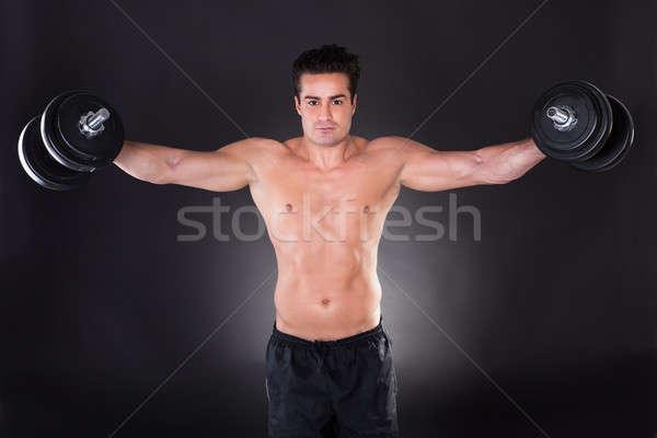 Man Exercising Dumbbells Stock photo © AndreyPopov