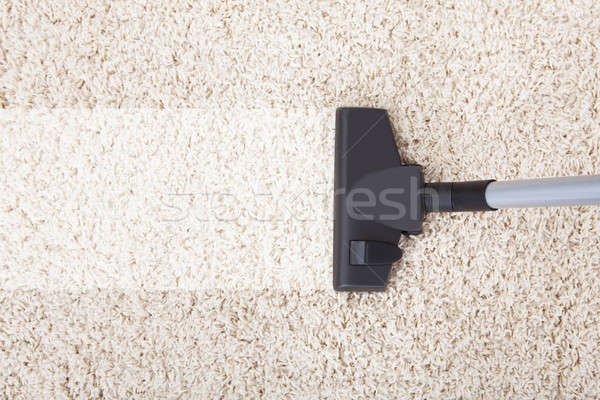 Vacuum Cleaner On Rug At Home Stock photo © AndreyPopov
