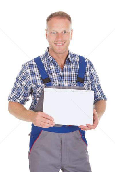 Handyman Holding Blank Placard Stock photo © AndreyPopov