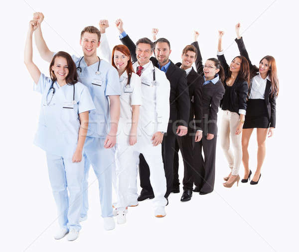 Doctors and managers cheering Stock photo © AndreyPopov