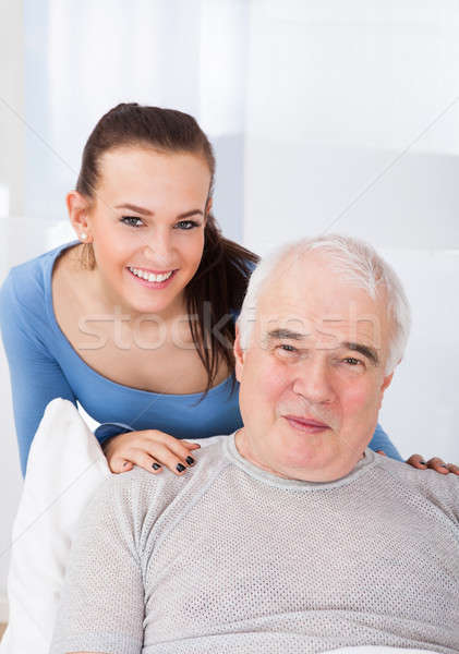 Portrait Of Happy Caregiver With Senior Man Stock photo © AndreyPopov