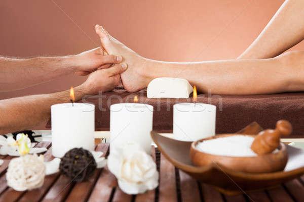Therapist Massaging Customer's Foot At Beauty Spa Stock photo © AndreyPopov