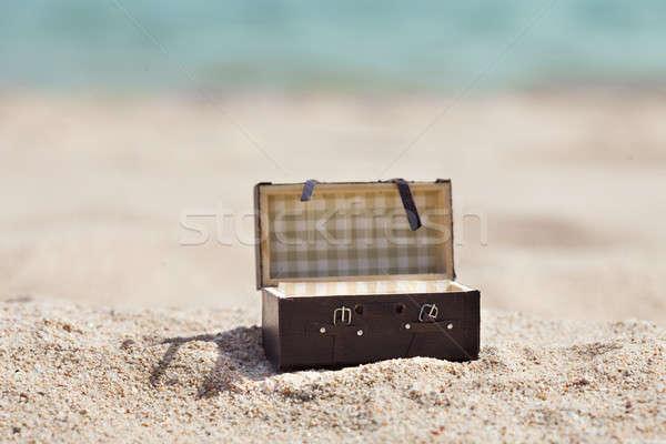 Open Suitcase On Beach Stock photo © AndreyPopov