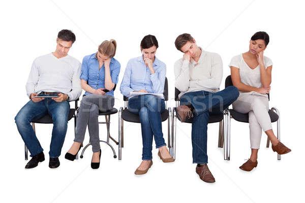 Unatkozik üzletemberek ül székek teljes alakos fehér Stock fotó © AndreyPopov