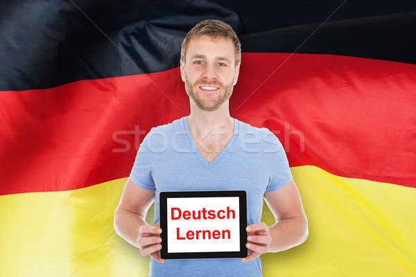 Man Holding Digital Tablet With Learn German Text Stock photo © AndreyPopov