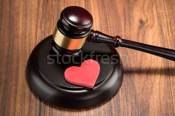 Gavel And Red Heart On Table Stock photo © AndreyPopov