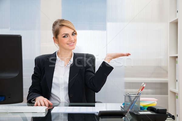 Businesswoman Displaying Invisible Product Stock photo © AndreyPopov