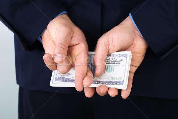 üzletember ujj tart bankjegyek áll mögött Stock fotó © AndreyPopov
