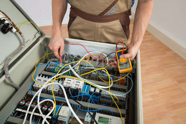 Stock photo: Electrician Checking A Fuse Box