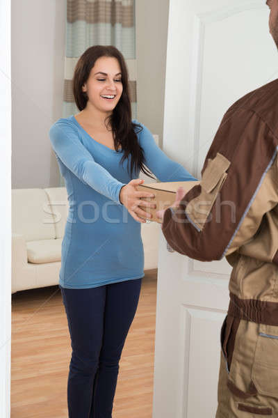 Young Woman Receiving Courier From Delivery Man Stock photo © AndreyPopov