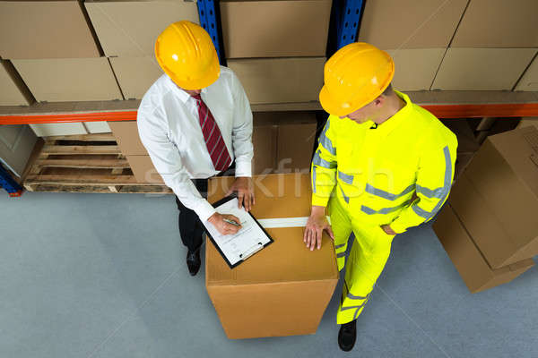 Warehouse Manager Checking Inventory In Warehouse Stock photo © AndreyPopov