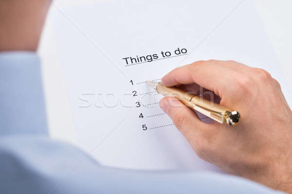 Businessperson Writing Things To Do On Paper Stock photo © AndreyPopov