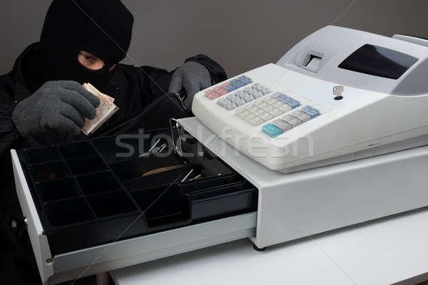 Betörő lop pénz maszk pénztárgép férfi Stock fotó © AndreyPopov