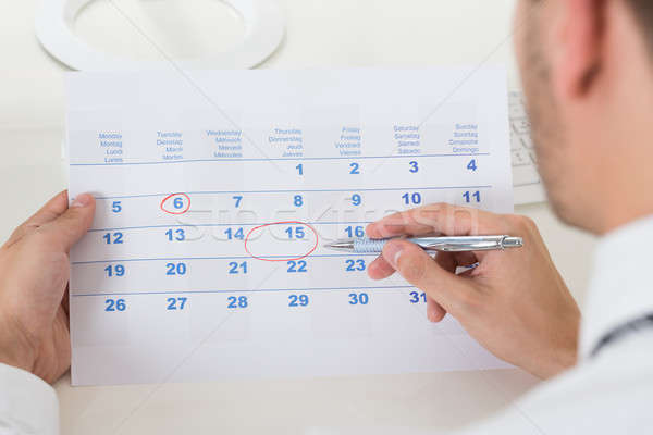 Close-up Of Businessman Marking Date Stock photo © AndreyPopov