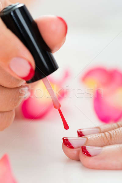 Female Hands Applying Nail Varnish Stock photo © AndreyPopov
