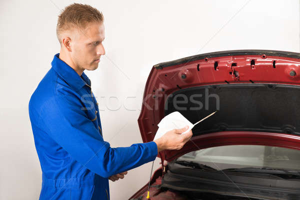 Mechanic Checking Oil Level In Car Engine Stock photo © AndreyPopov