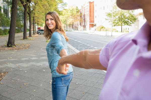 Woman Pulling Her Husband Stock photo © AndreyPopov