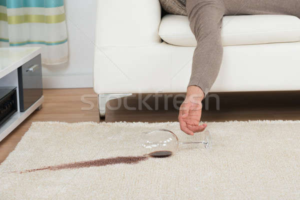 Drunk Man Spilling Red Wine On Rug Stock photo © AndreyPopov