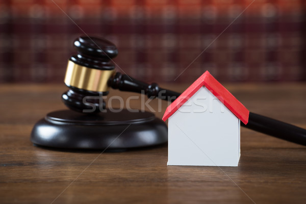 Mallet With House Model On Table In Courtroom Stock photo © AndreyPopov