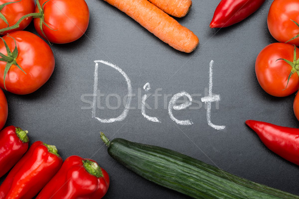 Diet Written Amidst Fresh Vegetables On Blackboard Stock photo © AndreyPopov