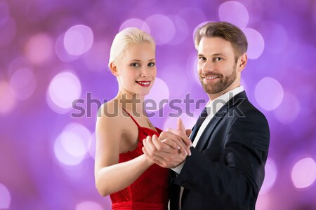 Passionate Man Removing Dress Strap From Woman's Shoulder Stock photo © AndreyPopov