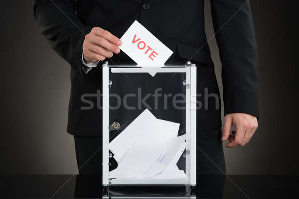 Male Hand Putting Vote Into A Ballot Box Stock photo © AndreyPopov